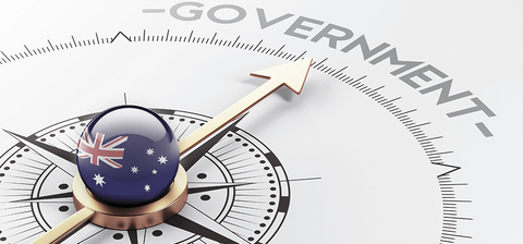 Stock image of a compass pointing to the word Government